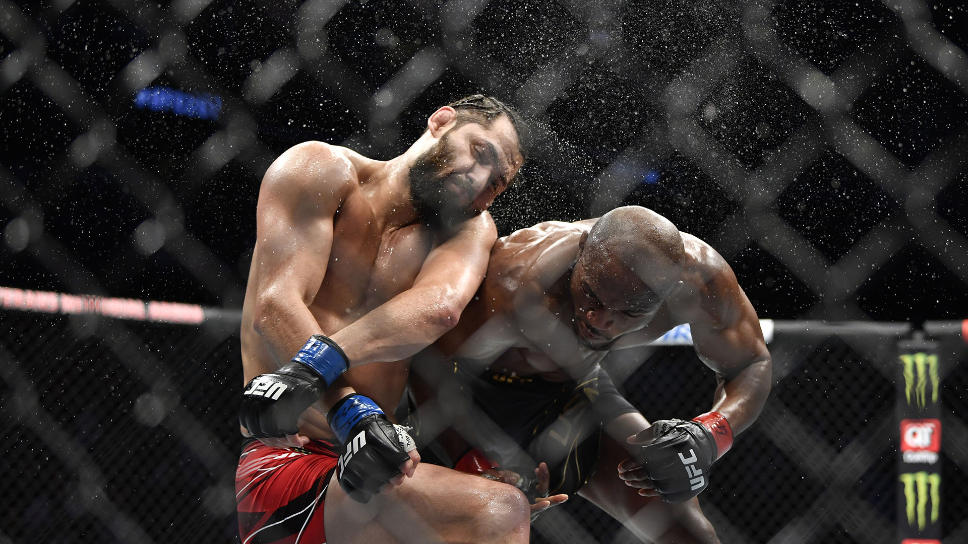Kamaru Usman of Nigeria punches Jorge Masvidal in their UFC welterweight championship bout during the UFC 261 event at VyStar Veterans Memorial Arena on April 24 2021 in Jacksonville Florida (Photo by Chris Unger/Zuffa LLC)