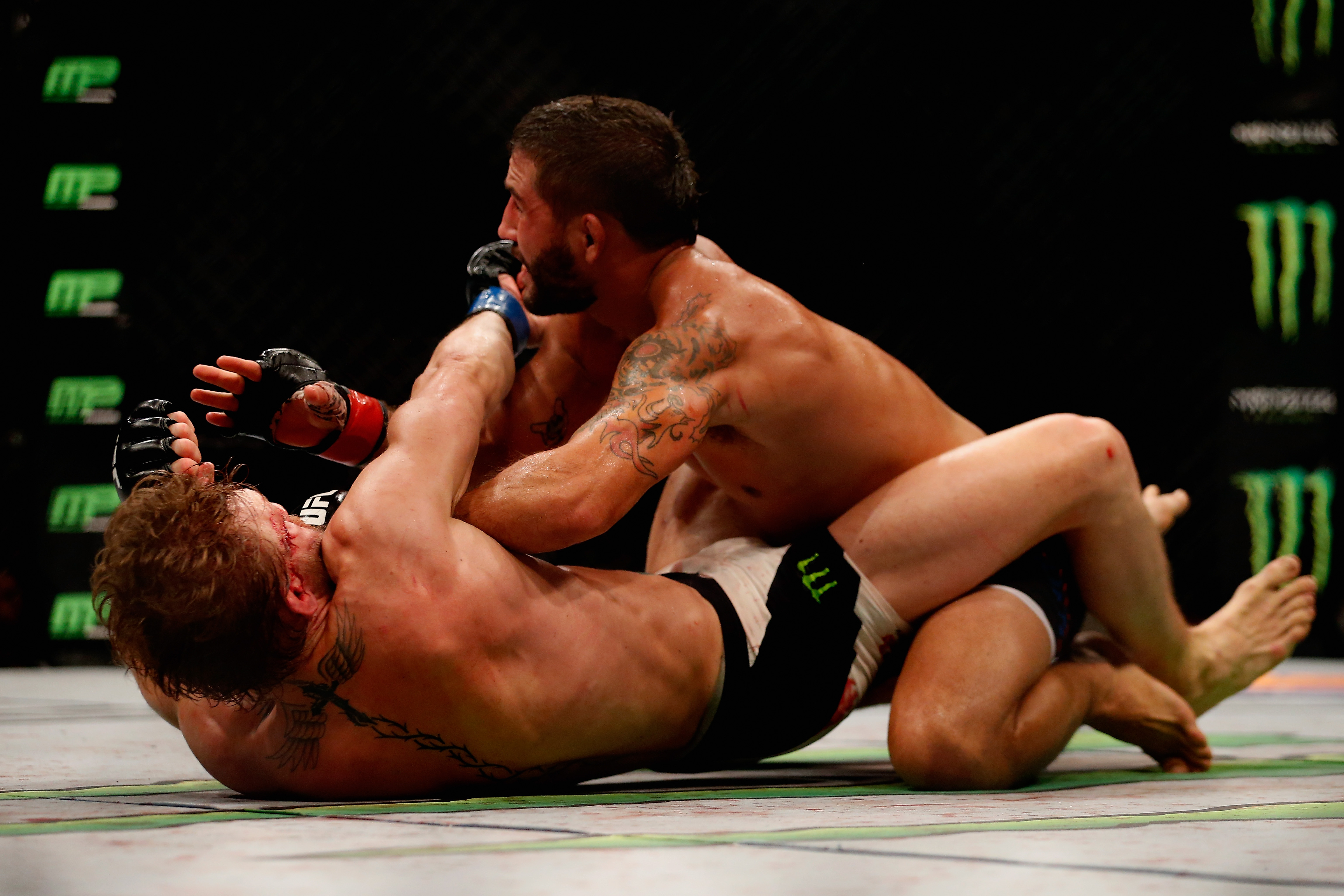 Conor McGregor punches Chad Mendes in their UFC interim featherweight title fight during the UFC 189 event inside MGM Grand Garden Arena on July 11, 2015 in Las Vegas, Nevada. (Photo by Christian Petersen/Zuffa LLC)