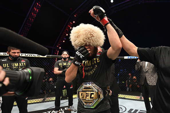 Khabib Nurmagomedov of Russia celebrates his victory over Justin Gaethje in their lightweight title bout during the UFC 254 event on October 25, 2020 on UFC Fight Island, Abu Dhabi, United Arab Emirates. (Photo by Josh Hedges/Zuffa LLC)
