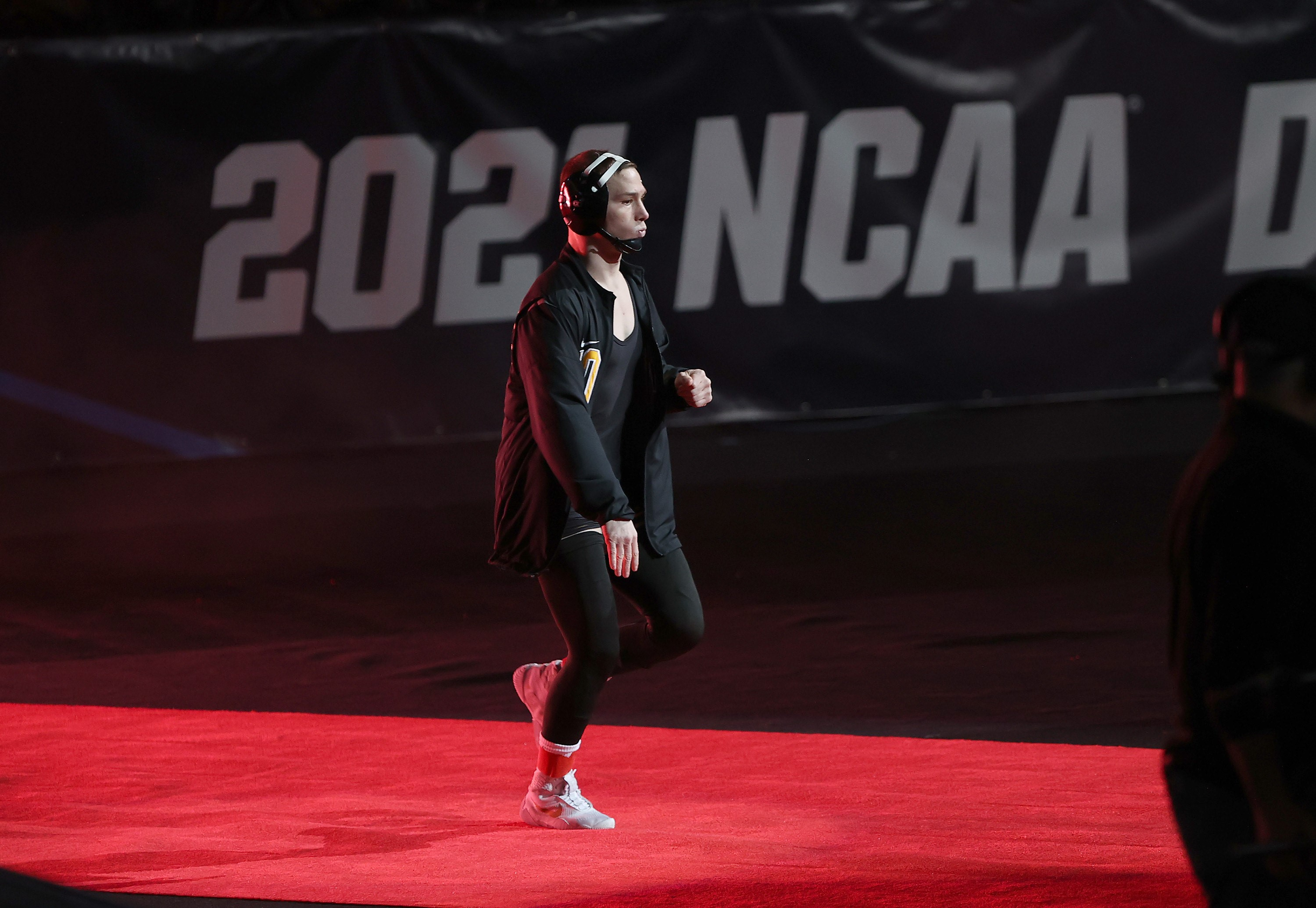 Spencer Lee walks out in the 125-pound finals at the 2021 NCAA Division I National Wrestling Tournament (Photo by Darren Miller/Iowa Athletics)