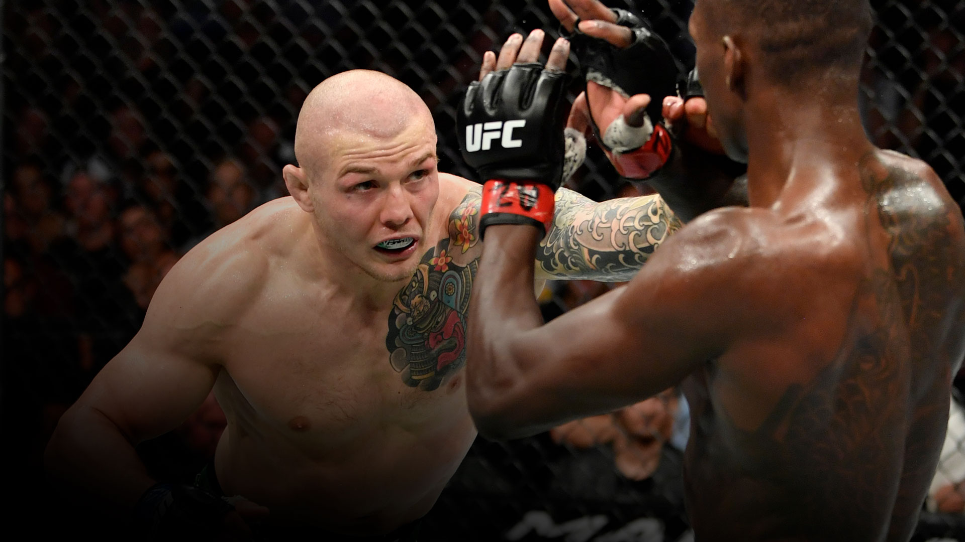 Marvin Vettori of Italy punches Israel Adesanya of Nigeria in their UFC middleweight championship fight during the UFC 263 event at Gila River Arena on June 12, 2021 in Glendale, Arizona. (Photo by Jeff Bottari/Zuffa LLC)