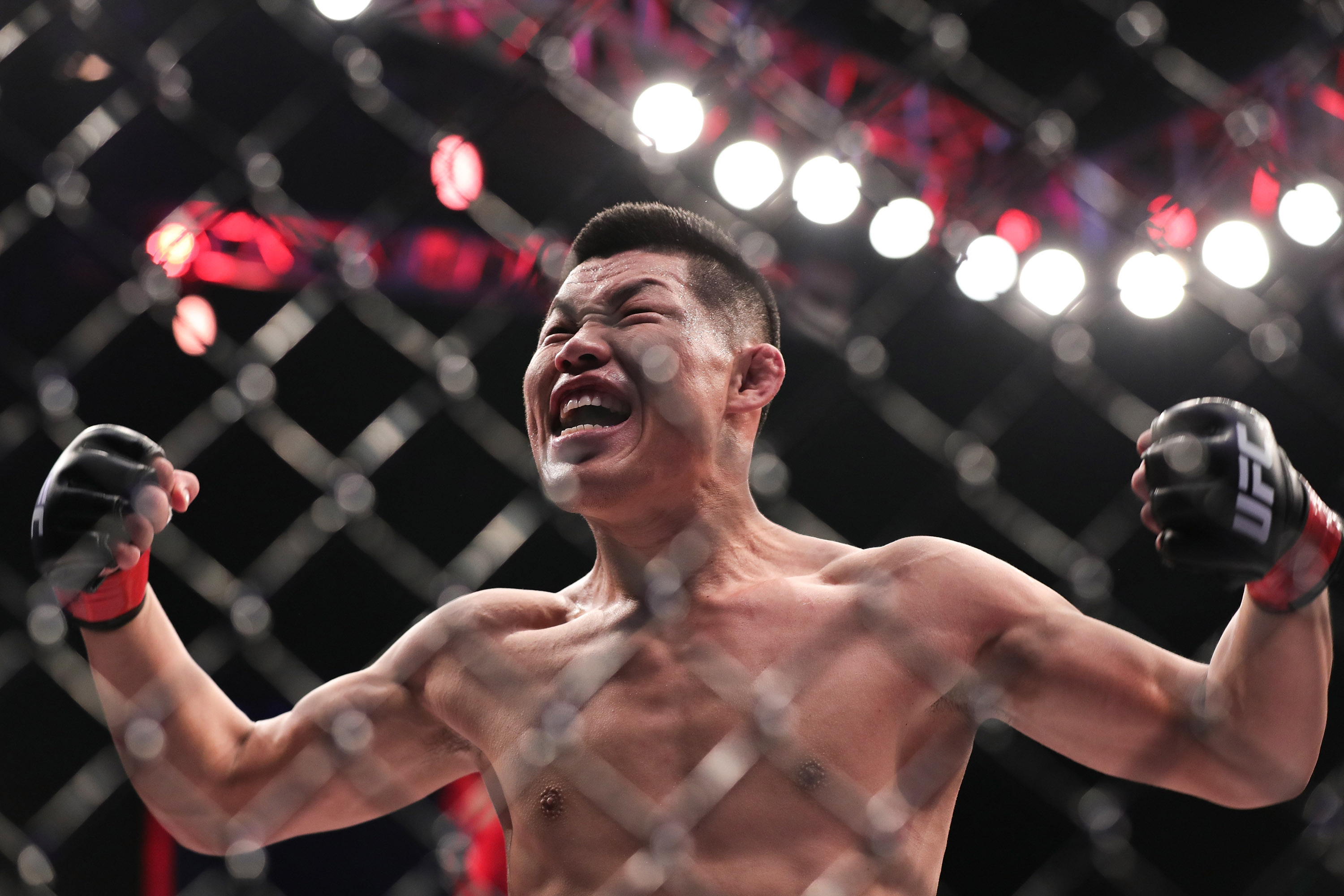 Li Jingliang of China celebrates after his TKO victory over David Zawada of Germany in their welterweight bout during the UFC Fight Night event at Cadillac Arena on November 24, 2018 in Beijing, China. (Photo by Emmanuel Wong/Getty Images)