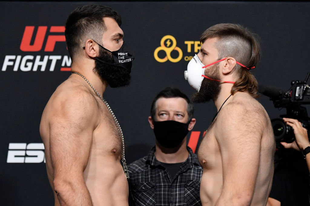 Co-main event opponents Andrei Arlovski of Belarus and Tanner Boser of Canada face off during the UFC weigh-in at UFC APEX on November 06, 2020 in Las Vegas, Nevada