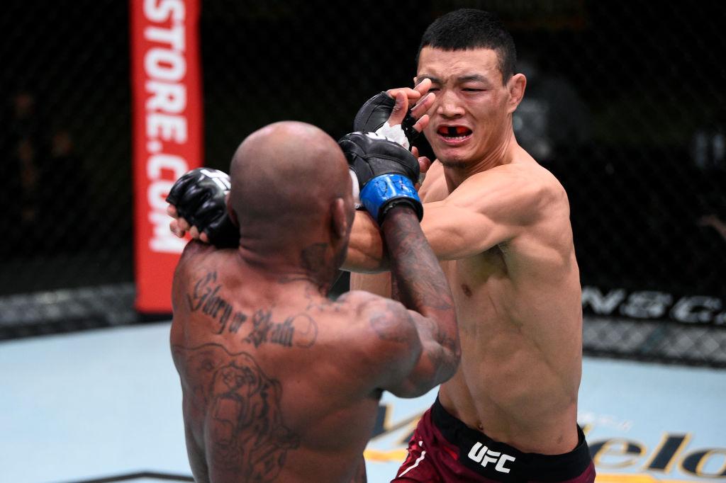 LAS VEGAS, NEVADA - NOVEMBER 28: (R-L) Su Mudaerji of Tibet punches Malcolm Gordon in their flyweight bout during the UFC Fight Night