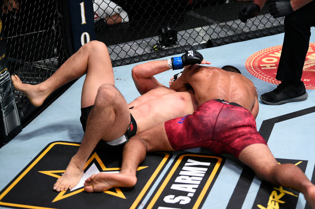 LAS VEGAS, NEVADA - NOVEMBER 28: (R-L) Miguel Baeza submits Takashi Soto of Japan in their welterweight bout during the UFC Fight Night