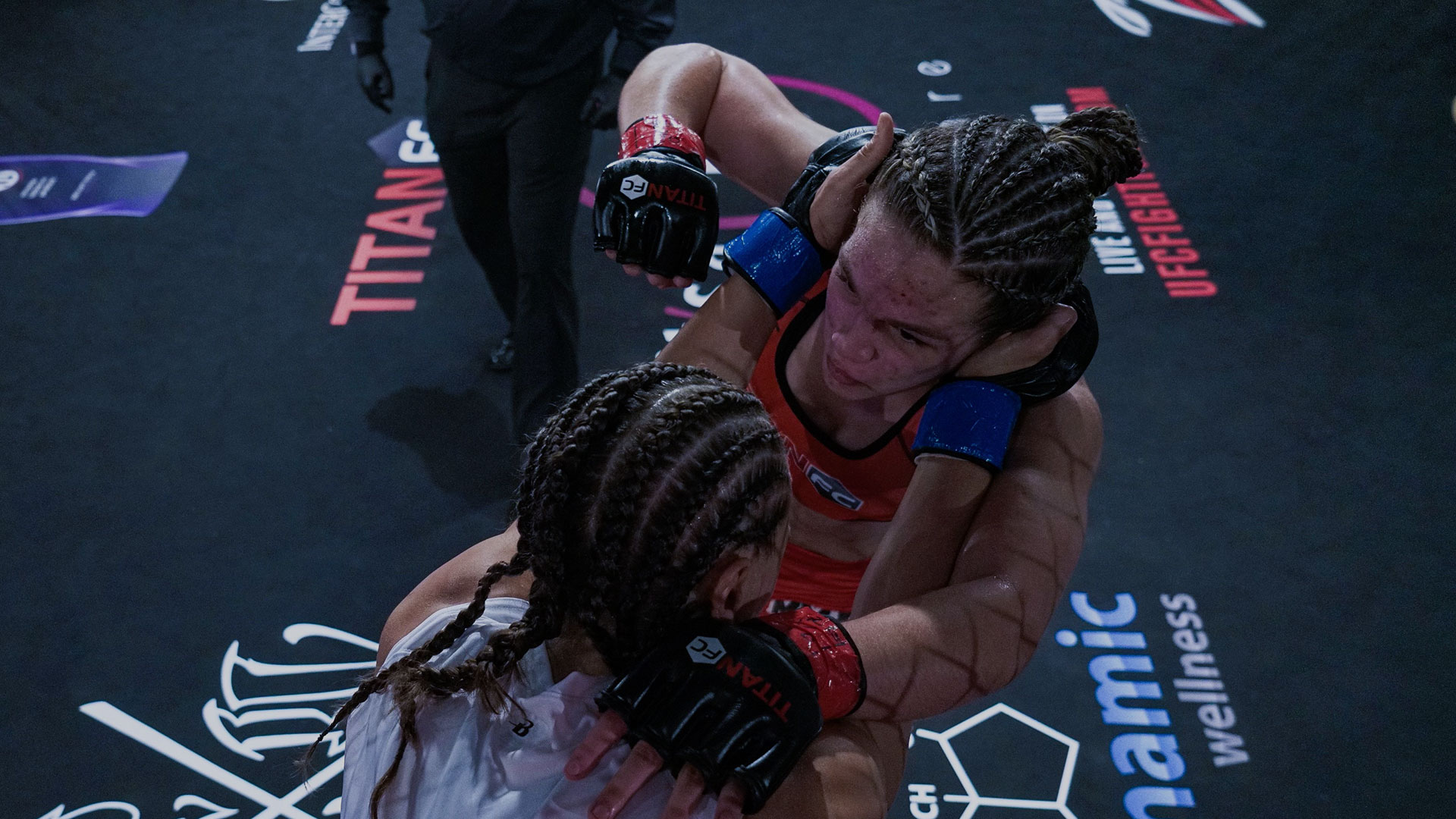 Evelyn Martins throws a punch against opponent Serena DeJesus at Titan FC