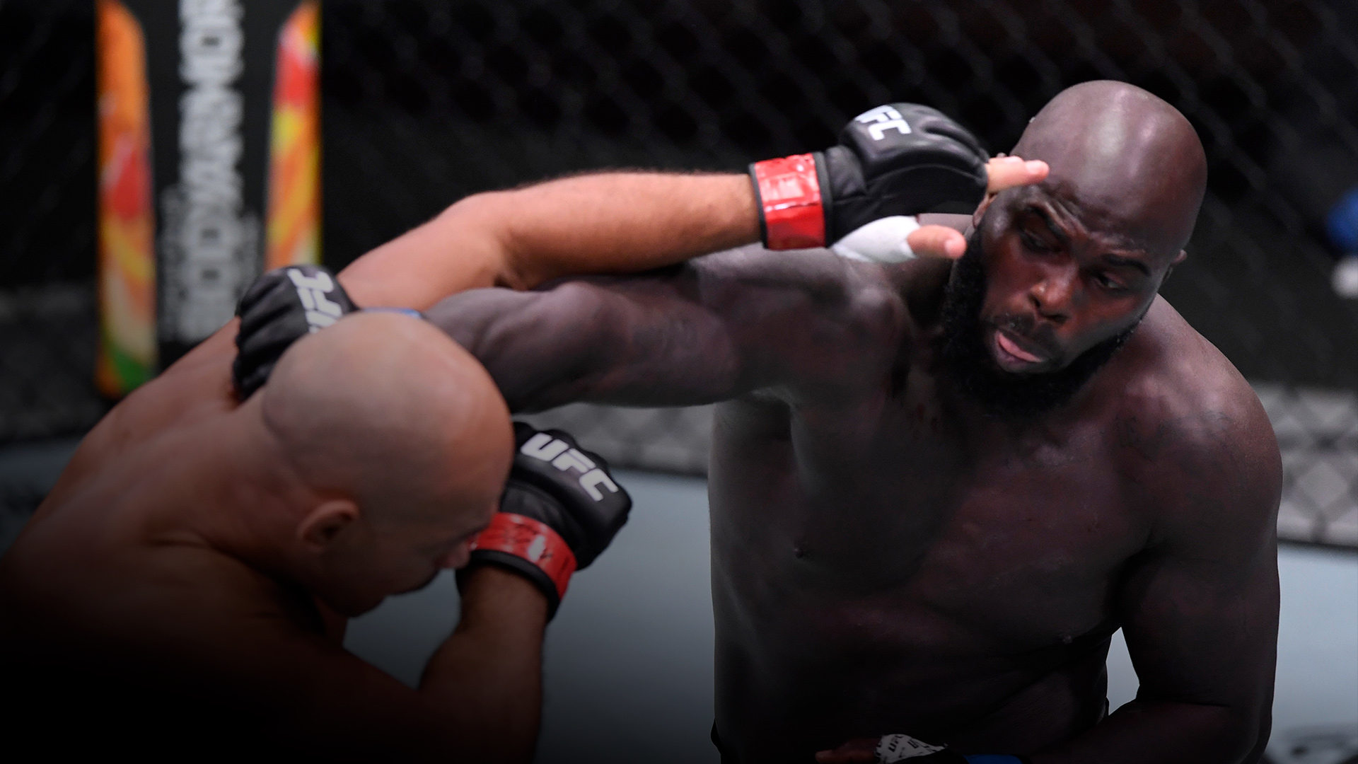Jairzinho Rozenstruik of Suriname punches Junior Dos Santos of Brazil in their heavyweight bout during the UFC 252 event at UFC APEX on August 15, 2020 in Las Vegas, Nevada. (Photo by Chris Unger/Zuffa LLC)