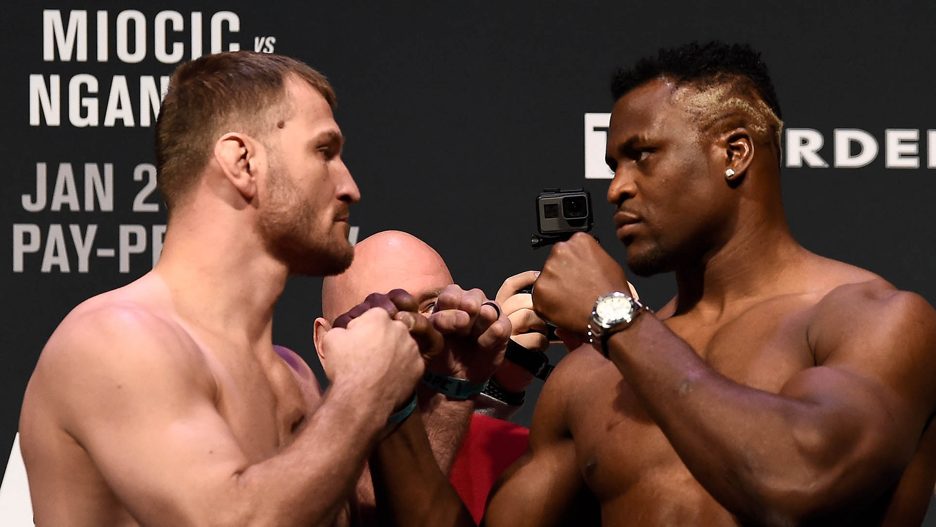 (L-R) Stipe Miocic and Francis Ngannou of Cameroon face off during the UFC 220 weigh-in at TD Garden on January 19, 2018 in Boston, Massachusetts. (Photo by Jeff Bottari/Zuffa LLC/Zuffa LLC via Getty Images)
