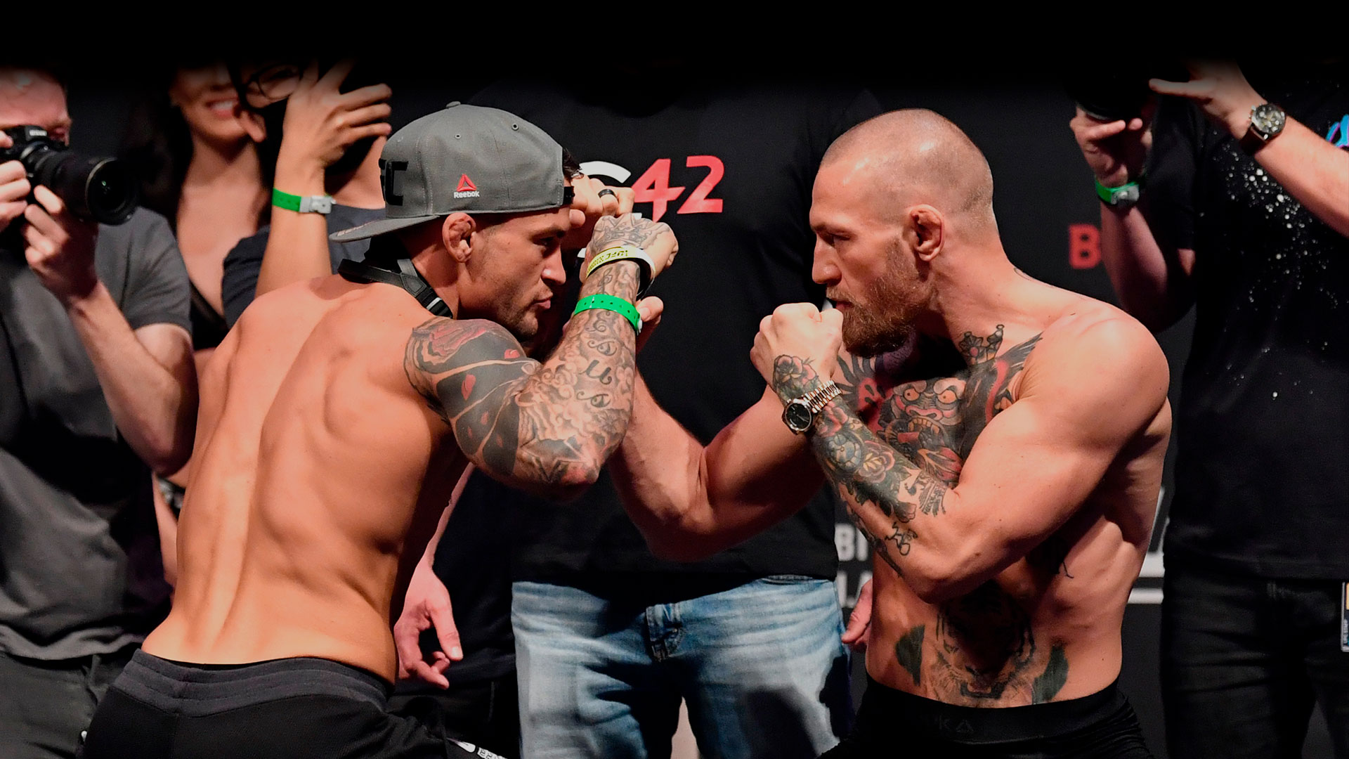 Dustin Poirier and Conor McGregor face off before UFC 257
