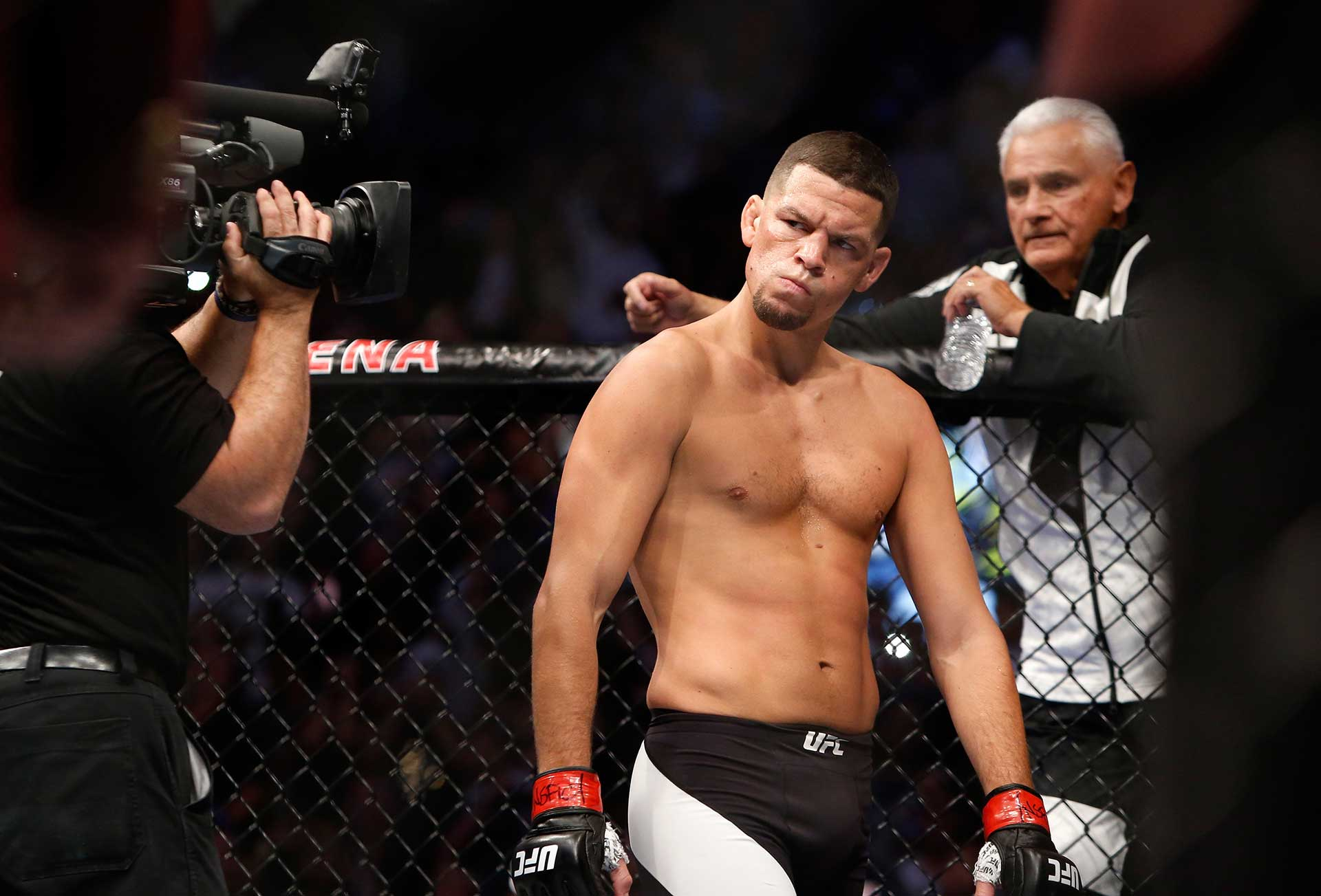 Nate Diaz eyes Conor McGregor from across the Octagon before their welterweight rematch at the UFC 202 event at T-Mobile Arena on August 20, 2016 in Las Vegas, Nevada. McGregor won by majority decision. (Photo by Steve Marcus/Getty Images)
