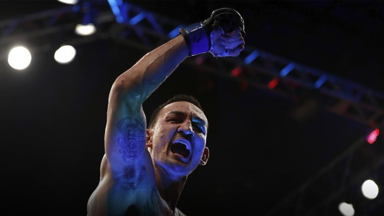 RIO DE JANEIRO, BRAZIL - JUNE 03: Max Holloway celebrates after his TKO victory over Jose Aldo of Brazil in their UFC featherweight championship bout during the UFC 212 event at Jeunesse Arena on June 3, 2017 in Rio de Janeiro, Brazil. (Photo by Buda Mendes/Zuffa LLC/Zuffa LLC via Getty Images)