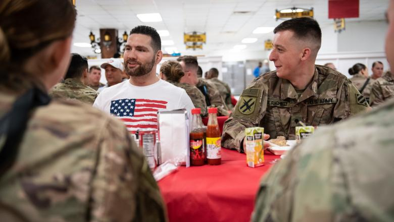 Chris Weidman talks with members of the U.S. military during a USO Tour.