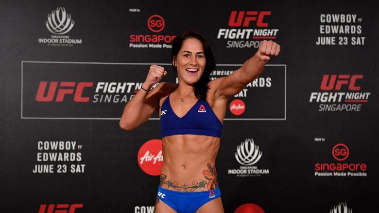 SINGAPORE - JUNE 22: Jessica Eye poses on the scale during the UFC Fight Night weigh-in at the Mandarin Oriental on June 22, 2018 in Singapore. (Photo by Jeff Bottari/Zuffa LLC/Zuffa LLC via Getty Images)