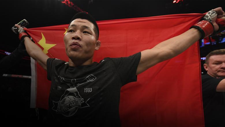 BEIJING, CHINA - NOVEMBER 24: Li Jingliang of China celebrates after his TKO victory over David Zawada of Germany in their welterweight bout during the UFC Fight Night event inside Cadillac Arena on November 24, 2018 in Beijing, China. (Photo by Jeff Bottari/Zuffa LLC/Zuffa LLC via Getty Images)