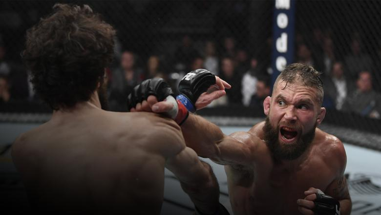 Jeremy Stephens punches Zabit Magomedsharipov of Russia in their featherweight bout during the UFC 235 event at T-Mobile Arena on March 2, 2019 in Las Vegas, Nevada.