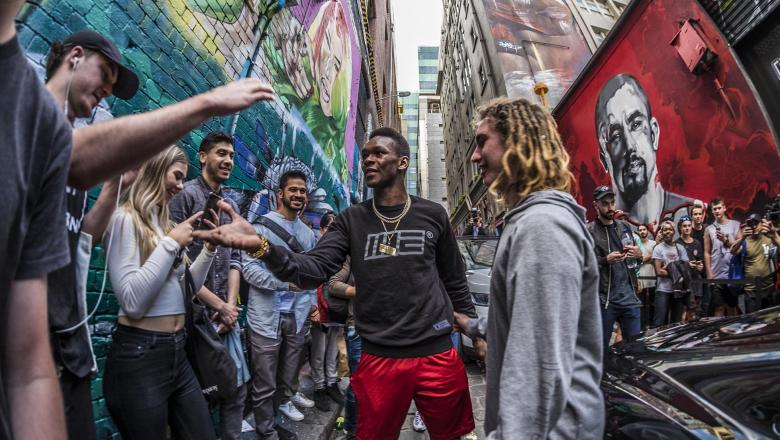 Israel Adesanya Interacts With Fans At The Unveiling Of His Mural On Hosier Lane in Melbourne, AU, October 2019 (Photo by Juan Cardenas/Zuffa LLC)