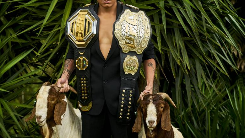 Double Champ Amanda Nunes Poses With Her Two Belts