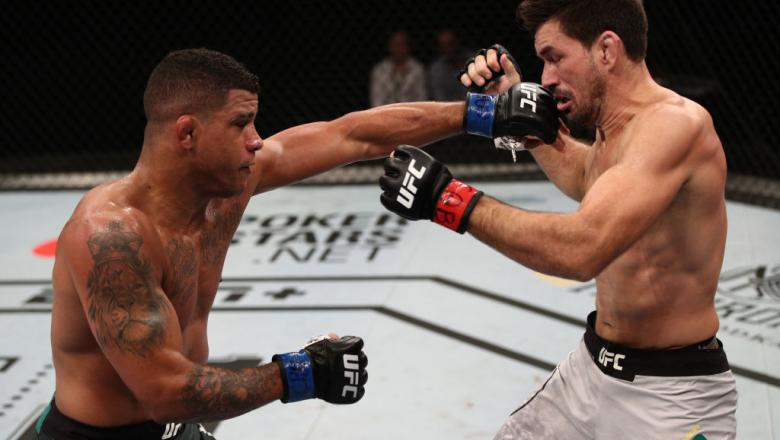 Gilbert Burns punches Demian Maia