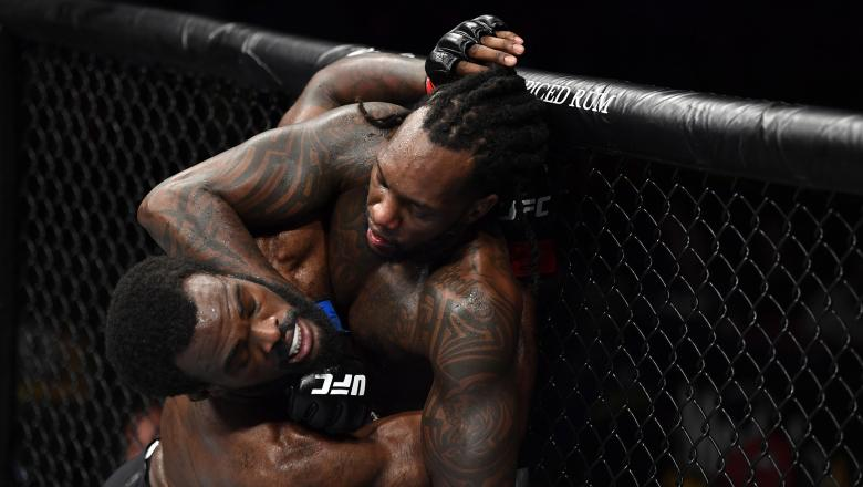 Dequan Townsend punches Bevon Lewis in their middleweight bout during the UFC Fight Night event at PNC Arena on January 25, 2020 in Raleigh, North Carolina. (Photo by Jeff Bottari/Zuffa LLC)