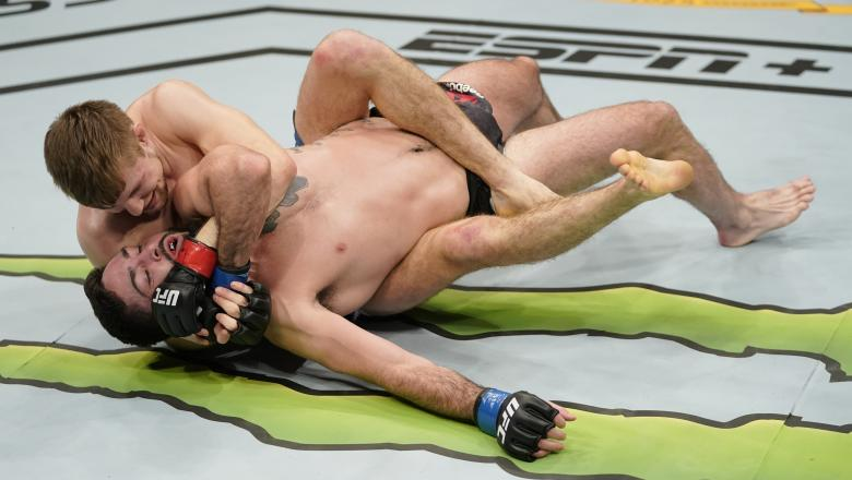 Bryce Mitchell grapples with Matt Sayles in their featherweight bout during the UFC Fight Night event at Capital One Arena on December 07, 2019 in Washington, DC. (Photo by Jeff Bottari/Zuffa LLC via Getty Images)