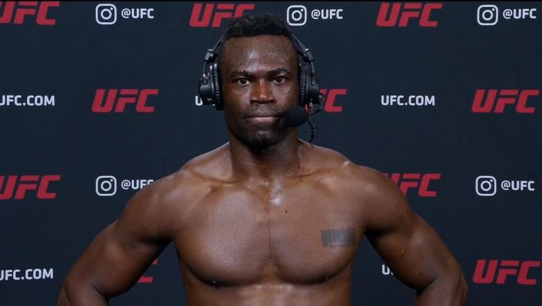 Uriah Hall talks with Michael Bisping after his win over Anderson Silva