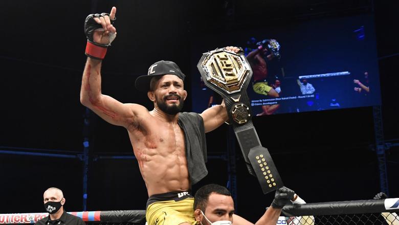 Deiveson Figueiredo celebrates after defeating Joseph Benavidez in their UFC flyweight championship bout on July 19, 2020 on UFC FIGHT ISLAND (Photo by Jeff Bottari/Zuffa LLC)