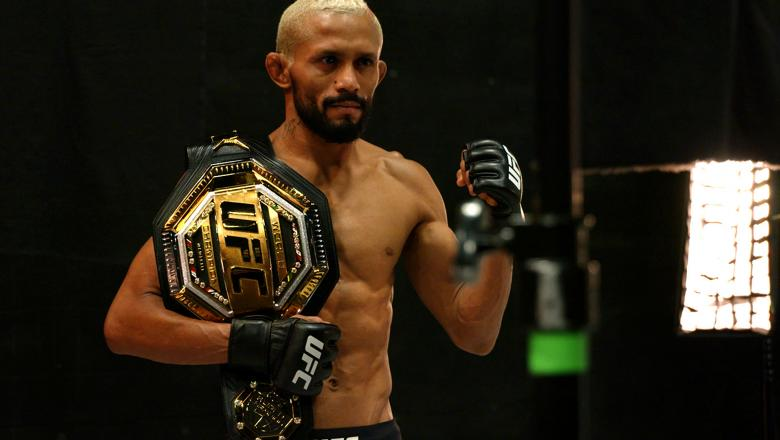Deiveson Figueiredo Poses With Flyweight Championship Belt