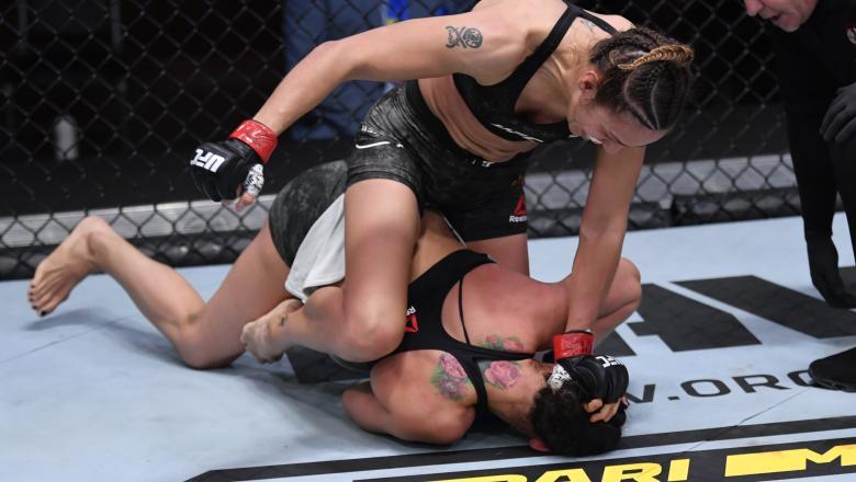 Antonina Shevchenko of Kyrgyzstan (top) punches Ariane Lipski of Brazil in their women's flyweight bout during the UFC 255 event at UFC APEX on November 21, 2020 in Las Vegas, Nevada. (Photo by Jeff Bottari/Zuffa LLC)