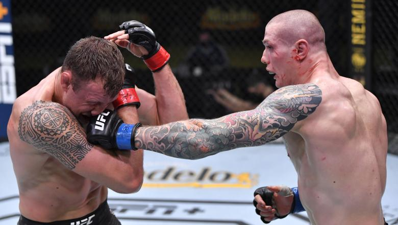 Marvin Vettori of Italy punches Jack Hermansson of Sweden in a middleweight bout during the UFC Fight Night event at UFC APEX on December 05, 2020 in Las Vegas, Nevada. (Photo by Chris Unger/Zuffa LLC)