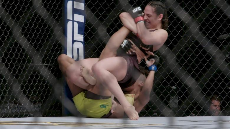 Ariane Lipski of Brazil secures a knee bar submission against Luana Carolina of Brazil in their flyweight bout during the UFC Fight Night event inside Flash Forum on UFC Fight Island on July 19, 2020