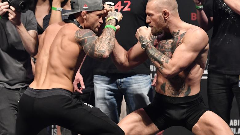 Dustin Poirier and Conor McGregor of Ireland face off during the UFC 257 weigh-in at Etihad Arena on UFC Fight Island on January 22, 2021 in Abu Dhabi, United Arab Emirates. (Photo by Jeff Bottari/Zuffa LLC)
