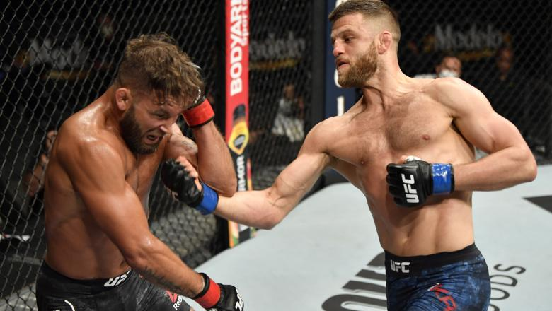 Calvin Kattar punches Jeremy Stephens in their featherweight fight during the UFC 249 event at VyStar Veterans Memorial Arena on May 09, 2020 in Jacksonville, Florida. (Photo by Jeff Bottari/Zuffa LLC)