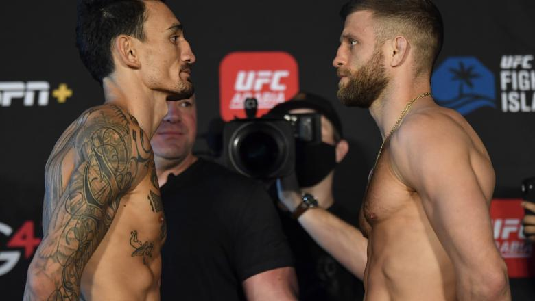 Max Holloway and Calvin Kattar face off during the UFC weigh-in at Etihad Arena on UFC Fight Island on January 15, 2021 in Abu Dhabi, United Arab Emirates. (Photo by Jeff Bottari/Zuffa LLC)
