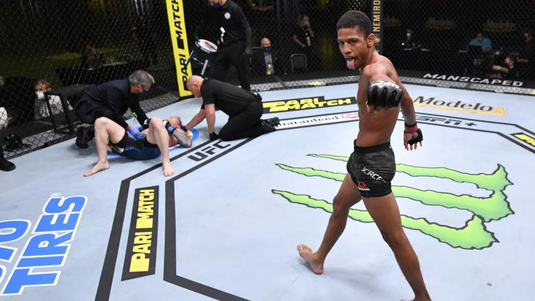Alex Caceres celebrates after his victory over Austin Springer in their featherweight fight during the UFC Fight Night event at UFC APEX on August 29, 2020 in Las Vegas, Nevada. (Photo by Jeff Bottari/Zuffa LLC)