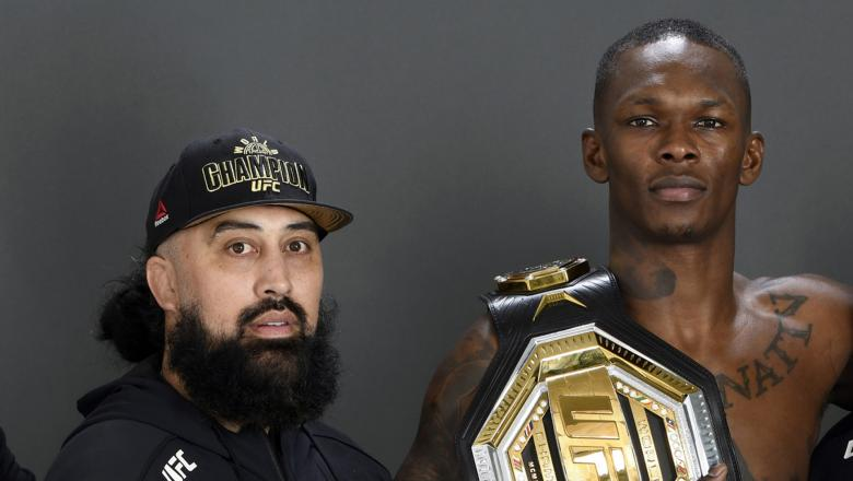 Israel Adesanya of Nigeria (C) poses for a post fight portrait with his coach Eugene Bareman (2nd left) and teammates backstage during UFC 253 inside Flash Forum on UFC Fight Island on September 27, 2020 in Abu Dhabi, United Arab Emirates. (Photo by Mike Roach/Zuffa LLC)