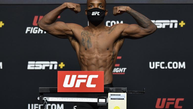 Leon Edwards of Jamaica poses on the scale during the UFC weigh-in at UFC APEX on March 12, 2021 in Las Vegas, Nevada. (Photo by Jeff Bottari/Zuffa LLC)