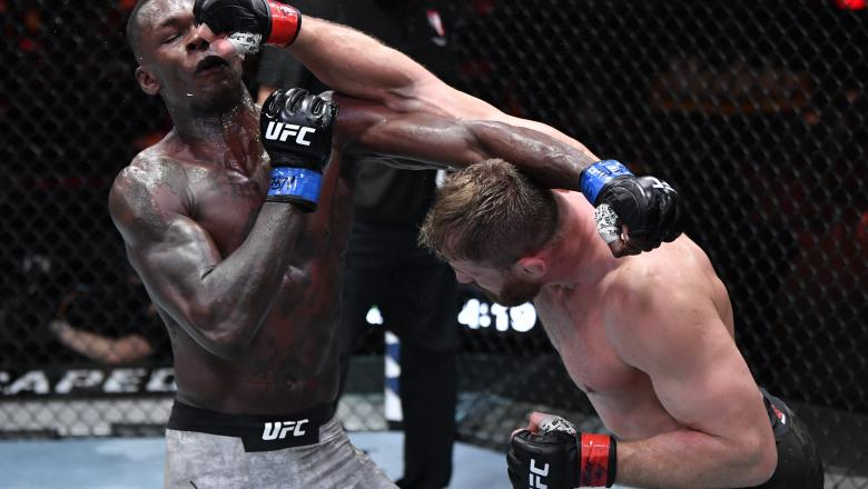 Jan Blachowicz of Poland punches Israel Adesanya of Nigeria in their UFC light heavyweight championship fight during the UFC 259 event at UFC APEX on March 06, 2021 in Las Vegas, Nevada. (Photo by Jeff Bottari/Zuffa LLC)