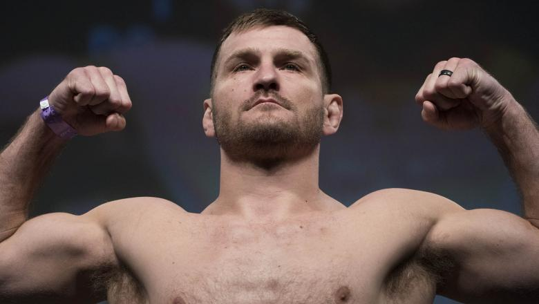 Stipe Miocic poses on the scale during the UFC 211 weigh-in at the American Airlines Center on May 12, 2017 in Dallas, Texas. (Photo by Cooper Neill/Zuffa LLC/Zuffa LLC via Getty Images)