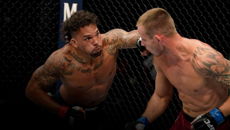 Eryk Anders punches Krzysztof Jotko of Poland in their middleweight fight during the UFC Fight Night event at VyStar Veterans Memorial Arena on May 16, 2020 in Jacksonville, Florida. (Photo by Cooper Neill/Zuffa LLC