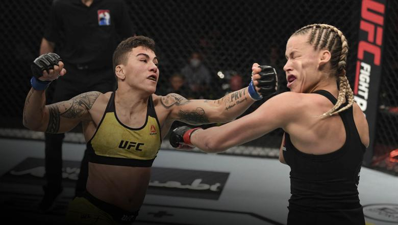Jessica Andrade of Brazil punches Katlyn Chookagian in their women's flyweight bout during the UFC Fight Night event inside Flash Forum on UFC Fight Island on October 18, 2020 in Abu Dhabi, United Arab Emirates. (Photo by Josh Hedges/Zuffa LLC via Getty Images)