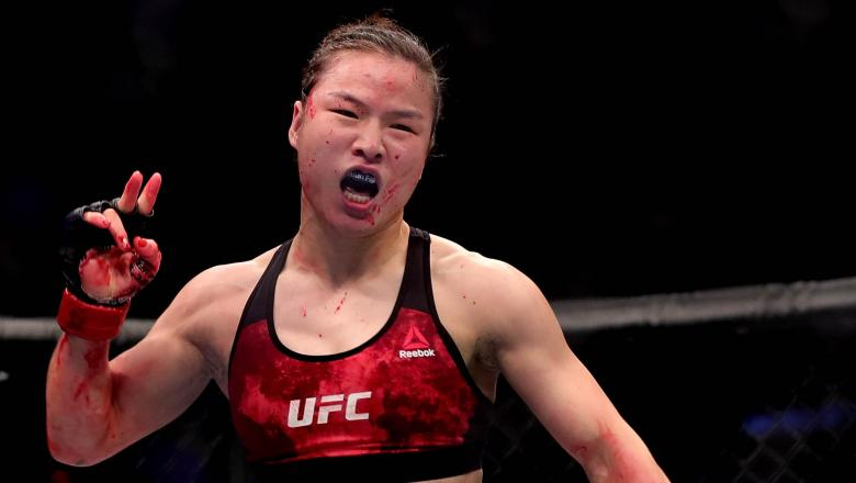 Weili Zhang of China celebrates after her submission victory over Jessica Aguilar in their women's strawweight bout during the UFC Fight Night event at Cadillac Arena on November 24, 2018 in Beijing, China. (Photo by Emmanuel Wong/Getty Images)