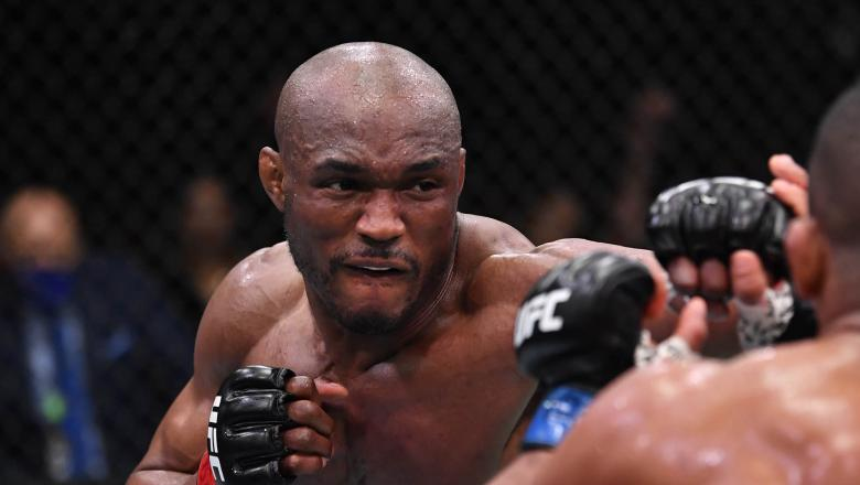 Kamaru Usman of Nigeria punches Gilbert Burns of Brazil in their UFC welterweight championship fight during the UFC 258 event at UFC APEX on February 13, 2021 in Las Vegas, Nevada. (Photo by Jeff Bottari/Zuffa LLC)