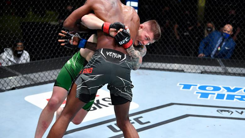 Marvin Vettori of Italy takes down Kevin Holland in a middleweight fight during the UFC Fight Night event at UFC APEX on April 10, 2021 in Las Vegas, Nevada. (Photo by Chris Unger/Zuffa LLC)