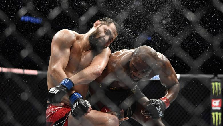 Kamaru Usman of Nigeria punches Jorge Masvidal in their UFC welterweight championship bout during the UFC 261 event at VyStar Veterans Memorial Arena on April 24, 2021 in Jacksonville, Florida. (Photo by Chris Unger/Zuffa LLC)