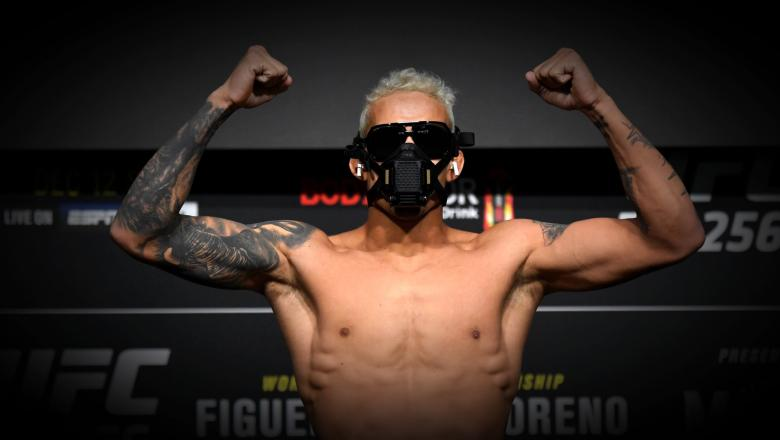 Charles Oliveira of Brazil poses on the scale during the UFC 256 weigh-in at UFC APEX on December 11, 2020 in Las Vegas, Nevada. (Photo by Jeff Bottari/Zuffa LLC via Getty Images)