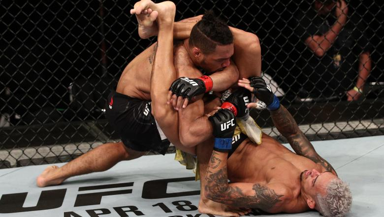 Charles Oliveira of Brazil attempts to secure a triangle choke against Kevin Lee in their lightweight fight during the UFC Fight Night event on March 14, 2020 in Brasilia, Brazil. (Photo by Buda Mendes/Zuffa LLC)