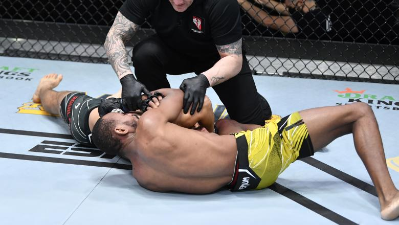 Carlston Harris secures a choke submission against Christian Aguilera in a welterweight fight during the UFC Fight Night event at UFC APEX on May 08, 2021 in Las Vegas, Nevada. (Photo by Chris Unger/Zuffa LLC)