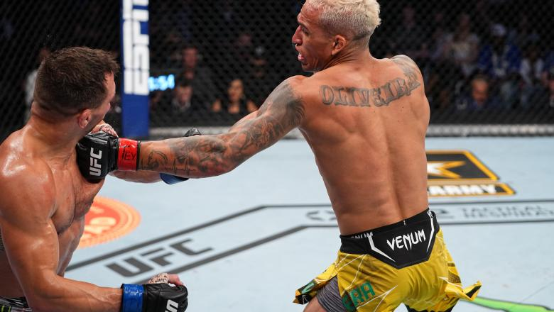 Charles Oliveira of Brazil punches Michael Chandler in their UFC lightweight championship bout at Toyota Center on May 15, 2021 in Houston, Texas. (Photo by Josh Hedges/Zuffa LLC)
