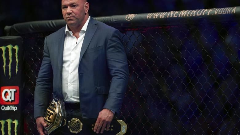 UFC President Dana White waits to place the UFC lightweight championship belt on Charles Oliveira of Brazil after defeating Michael Chandler in their lightweight championship bout during the UFC 262 event at Toyota Center on May 15, 2021 in Houston, Texas. (Photo by Cooper Neill/Zuffa LLC)