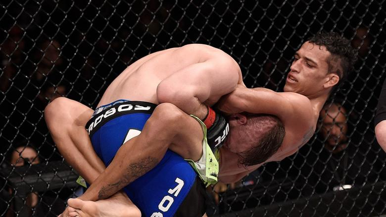 Charles Oliveira attempts to submit Nick Lentz of the United States in their featherweight UFC bout during the UFC Fight Night event at Arena Goiania on May 30, 2015 in Goiania, Brazil. (Photo by Buda Mendes/Zuffa LLC/Zuffa LLC via Getty Images)